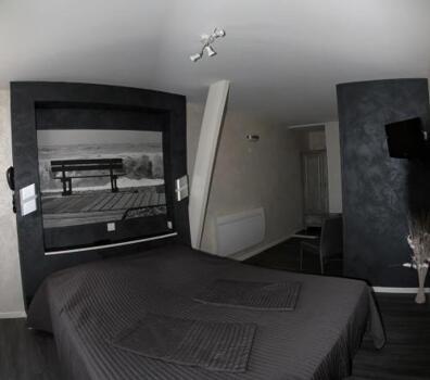 Foto de una habitación de Logis Le Neptune