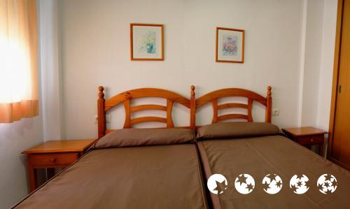 Foto di una camera da Apartamentos Turisticos Biarritz - Bloque I