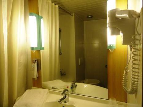 Foto del baño de Hotel Ibis Leiria