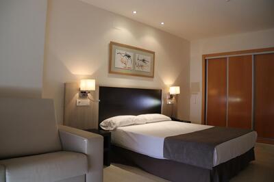 Foto de una habitación de Hotel Adaria Vera