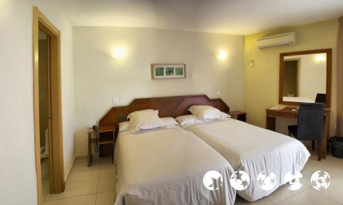 Foto de una habitación de Hotel Mainare Playa