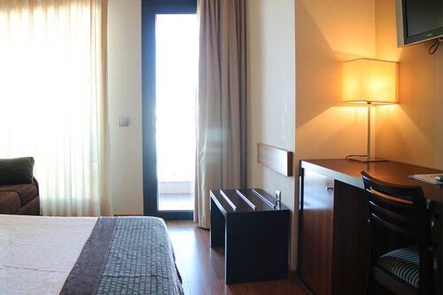 Foto de una habitación de Hotel y Apartamentos Conilsol